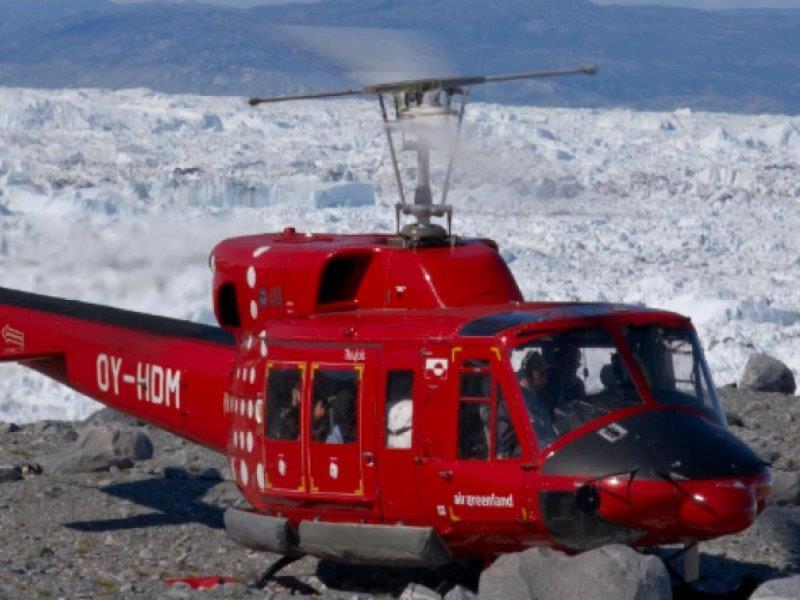 Обиколка с хеликоптер над ледения Фиорд Илулисат и престой в защитената зона
